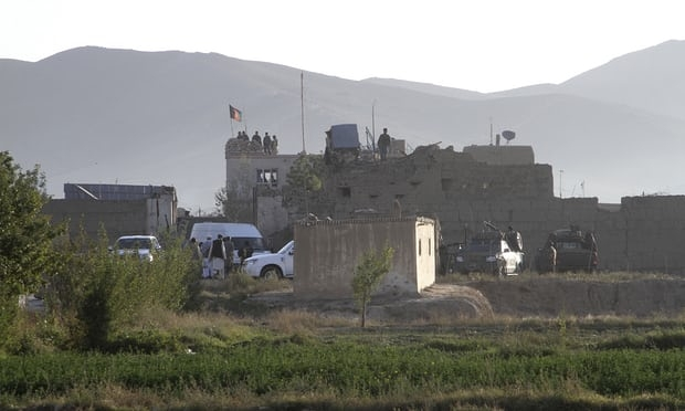 Afghan security forces stand guard on the roof of the main prison building after a Taliban attack in Ghazni. Photograph: Rahmatullah Nikzad/AP