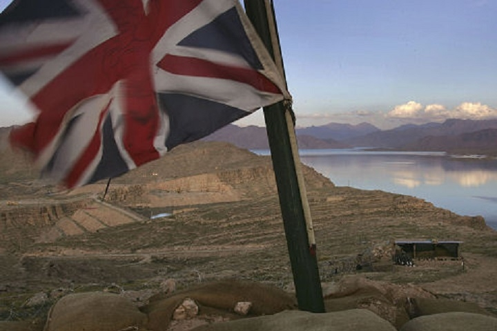 KAJAKI, AFGHANISTAN - MARCH 13:  A Union Jack flies at a Royal Marine outpost overlooking the Kajaki hydroelectric dam March 13, 2007 in Afghanistan's southern Helmand province. Some 4,500 NATO forces are battling Taliban in the area as part of Operation Achilles, the largest NATO operation yet in Afghanistan. The main objective of the offensive is to clear Taliban from the area in order to upgrade the dam, which currently provides electricity to much of southern Afghanistan. The USAID funded project would be the largest developement project in Afghanistan, providing electricy to millions more Afghans. Earlier work on the dam, which was completed by the United States in 1975, was suspended June 4, 2006 due to Taliban attacks.  (Photo by John Moore/Getty Images)
